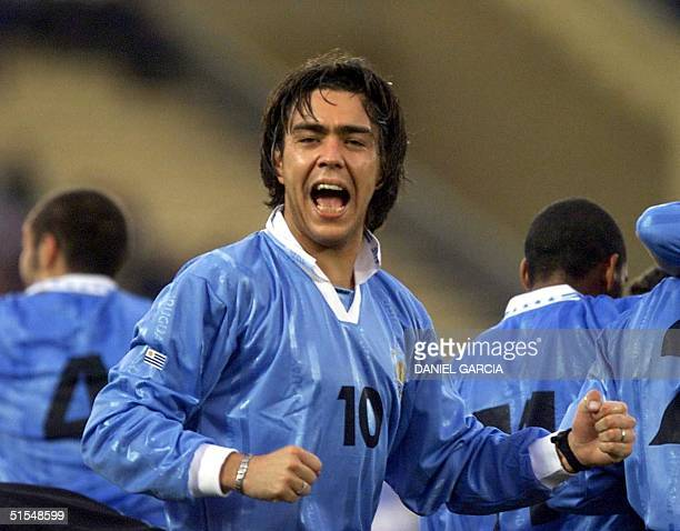 Uruguay's Alvaro Recoba celebrates the first goal scored by teammate Dario Silva against Chile during their JapanKorea 2002 World Cup elimination...
