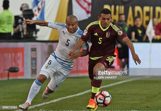 Uruguay's Carlos Sanchez and Venezuela's Arquimedes Figuera vie for the ball during the Copa America Centenario football match in Philadelphia...