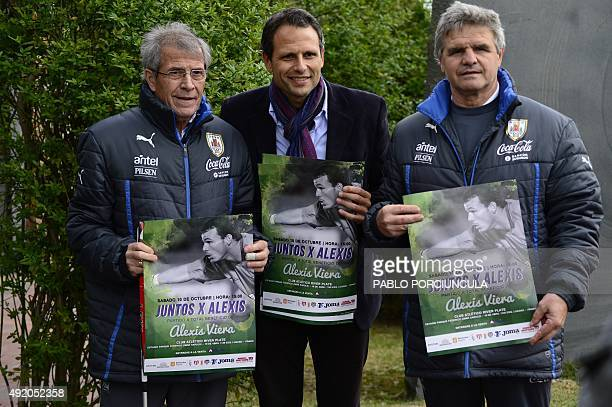 Uruguay's coach Oscar Washington Tabarez and his assistant Alejandro Otero pose with public relations Jorge Lenoble friend of Uruguayan goalkeeper...