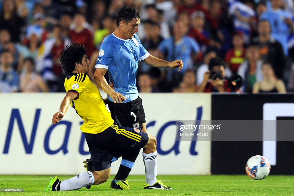 Uruguay's Cristian Rodriguez and Colombian defender Cristian Zapata vie during their Brazil 2014 FIFA World Cup South American qualifier match, in Montevideo on September 10, 2013.