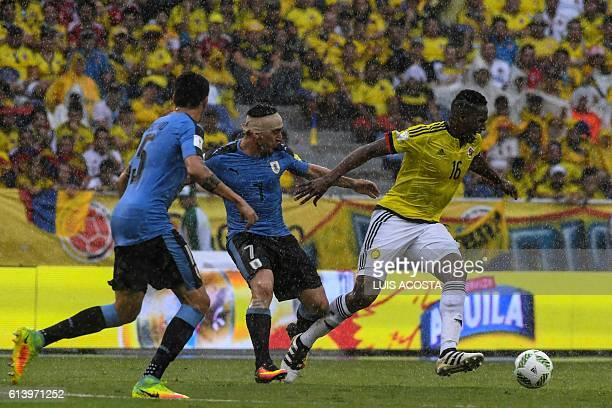 Uruguay's Cristian Rodriguez and Colombia's defender Yerry Mina vie for the ball during their Russia 2018 FIFA World Cup qualifier football match in...