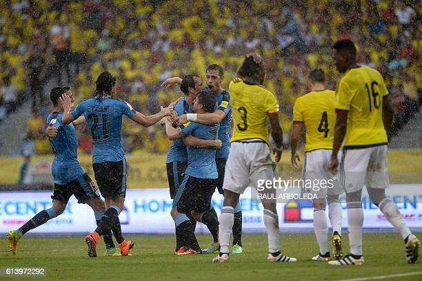 Uruguay's Cristian Rodriguez celebrates with Diego Godin and Sebastian Coates after scoring against Colombia during their Russia 2018 World Cup...