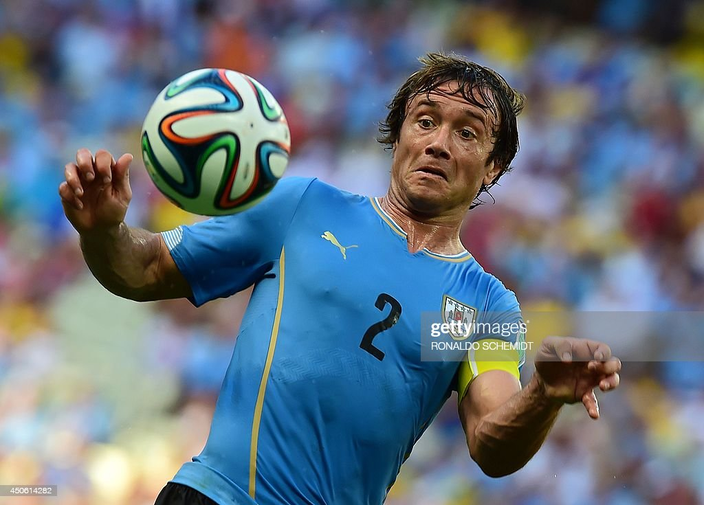 Uruguay's defender Diego Lugano in action during a Group D football match between Uruguay and Costa Rica at the Castelao Stadium in Fortaleza during...