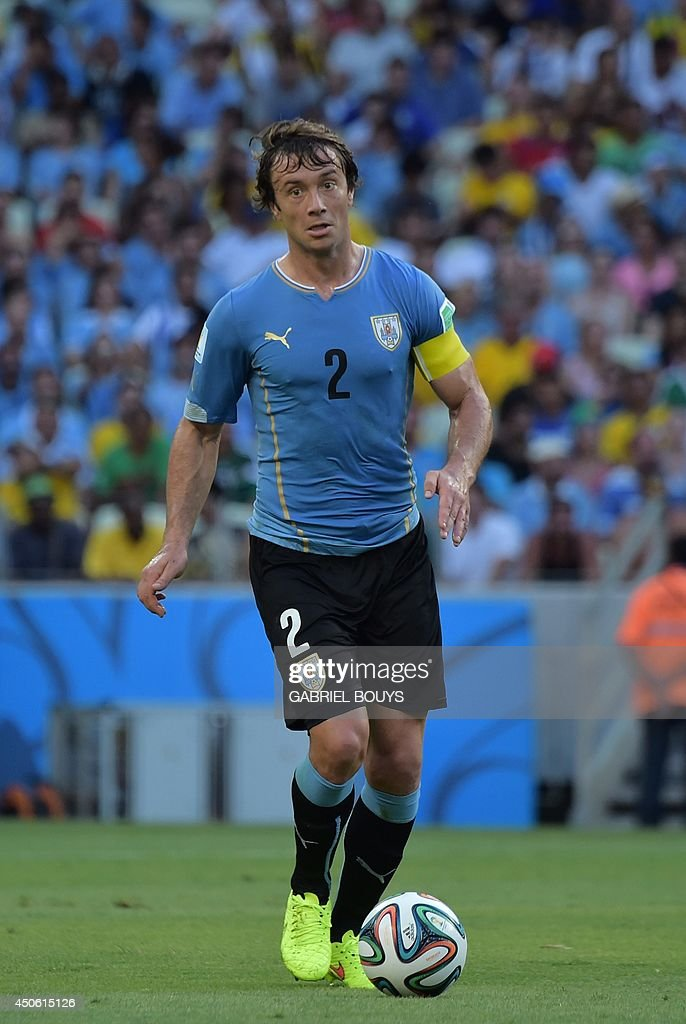 Uruguay's defender Diego Lugano plays the ball during a Group D football match between Uruguay and Costa Rica at the Castelao Stadium in Fortaleza...