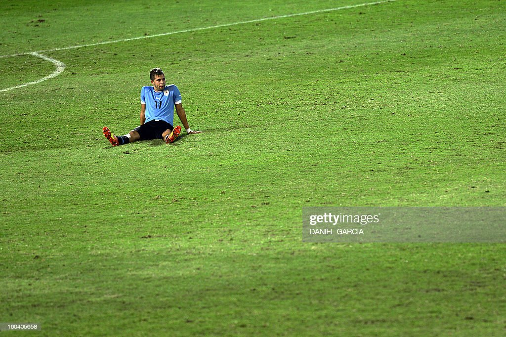 Uruguay's defender Gianni Danielle Rodriguez reacts at the end of the South American U-20 final round football match against Paraguay at Malvinas Argentinas stadium in Mendoza, Argentina, on January 30, 2013. Four teams will qualify for the FIFA U-20 World Cup Turkey 2013.