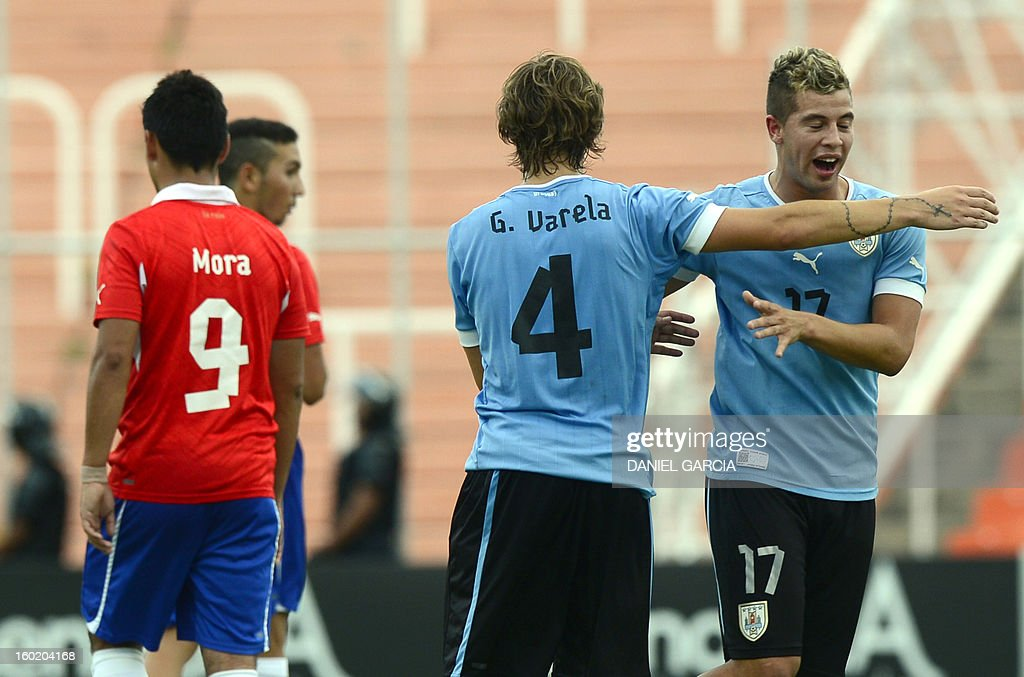 Uruguay's defender Guillermo Varella and defender Gianni Danielle Rodriguez (R) celebrate at the end the South American U-20 final round football match against Chile at Malvinas Argentinas stadium in Mendoza, Argentina, on January 27, 2013. Four teams will qualify for the FIFA U-20 World Cup Turkey 2013. Uruguay won 1-0.