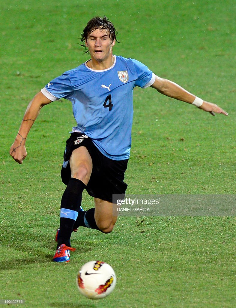 Uruguay's defender Guillermo Varella takes the ball with Uruguay's during their South American U-20 final round football match against Paraguay at Malvinas Argentinas stadium in Mendoza, Argentina, on January 30, 2013. Four teams will qualify for the FIFA U-20 World Cup Turkey 2013.