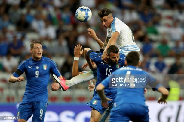 TOPSHOT Uruguay's defender Jose Gimenez vies with Italy's defender Andrea Barzagli during the friendly football match Italy vs Uruguay at the Allianz...