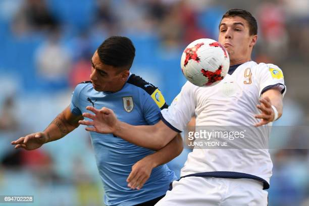 Uruguay's defender Jose Luis Rodriguez and Italy's forward Andrea Favilli compete for the ball during the U20 World Cup third place playoff football...