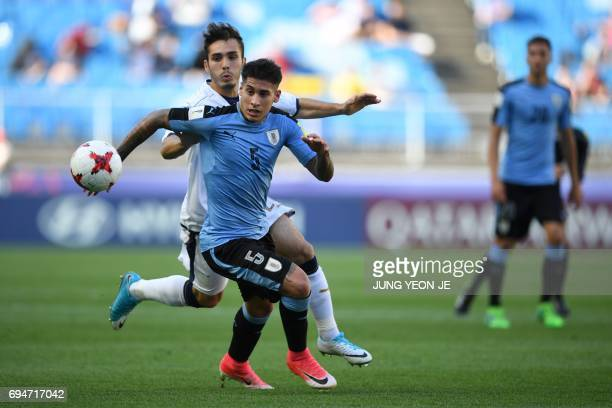 Uruguay's defender Mathias Olivera and Italy's midfielder Alfredo Bifulco compete for the ball during the U20 World Cup third place playoff football...