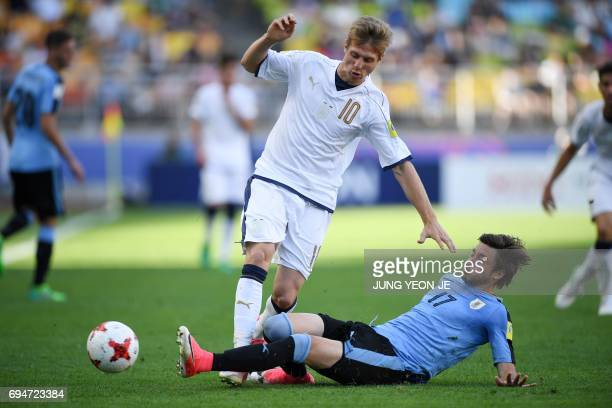 Uruguay's defender Matias Vina tackles Italy's forward Luca Vido during the U20 World Cup third place playoff football match between Uruguay and...