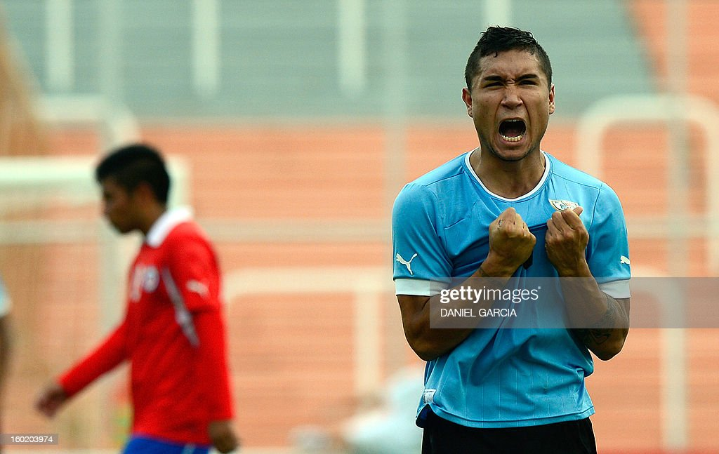 Uruguay's defender Maximiliano Moreira celebrates at the end the South American U-20 final round football match against Chile at Malvinas Argentinas stadium in Mendoza, Argentina, on January 27, 2013. Four teams will qualify for the FIFA U-20 World Cup Turkey 2013. Uruguay won 1-0.