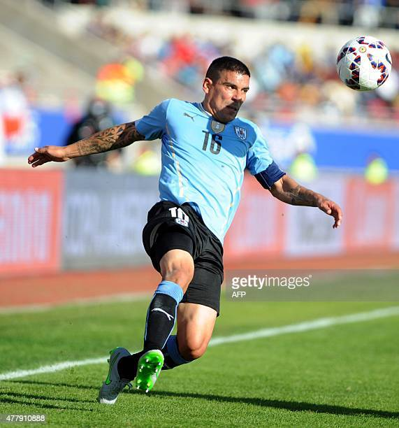 Uruguay's defender Maximiliano Pereira runs for the ball during their 2015 Copa America football championship match in La Serena on June 20 2015 AFP...