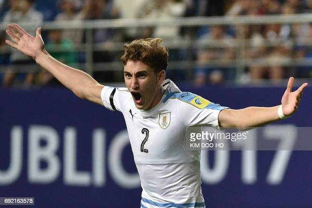 Uruguay's defender Santiago Bueno celebrates converting a penalty during the penalty shootout to win the U20 World Cup quarterfinal football match...