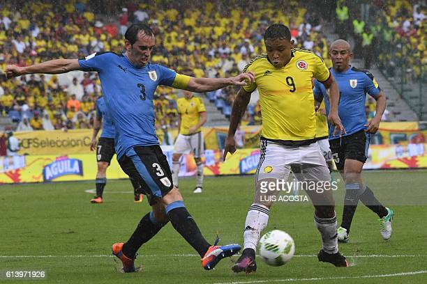 Uruguay's Diego Godin and Colombia's forward Luis Fernando Muriel vie for the ball during their Russia 2018 FIFA World Cup qualifier football match...