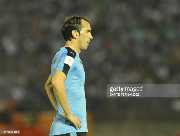 Uruguay's Diego Godin gestures during their 2018 FIFA World Cup qualifier football match against Brazil at the Centenario stadium in Montevideo on...