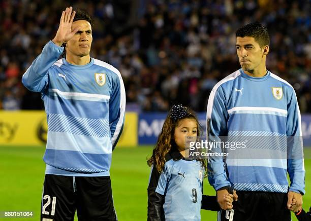 Uruguay's Edinson Cavani and Luis Suarez pose before the match against Bolivia during their 2018 World Cup football qualifier match in Montevideo on...