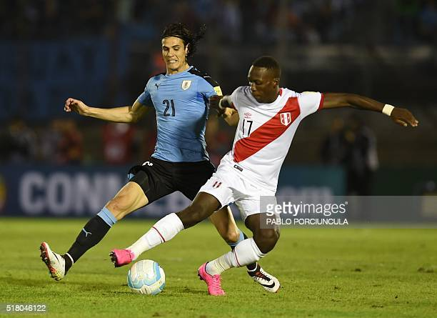 Uruguay's Edinson Cavani and Peru's Luis Advincula vie for the ball during their Russia 2018 FIFA World Cup South American Qualifiers' football match...
