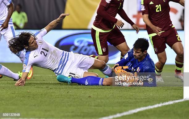 Uruguay's Edinson Cavani and Venezuela's Daniel Hernandez vie for the ball during the Copa America Centenario football match in Philadelphia...