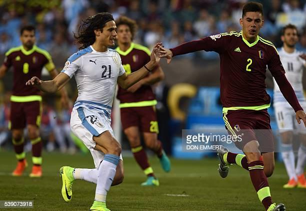 Uruguay's Edinson Cavani and Venezuela's Wilker Romero vie for the ball during the Copa America Centenario football tournament in Philadelphia...