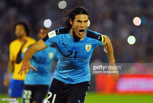 TOPSHOT Uruguay's Edinson Cavani celebrates after scoring against Brazil during their 2018 FIFA World Cup qualifier football match in Montevideo...