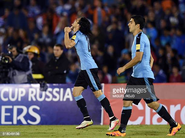 Uruguay's Edinson Cavani celebrates after scoring against Peru during their Russia 2018 FIFA World Cup South American Qualifiers' football match at...