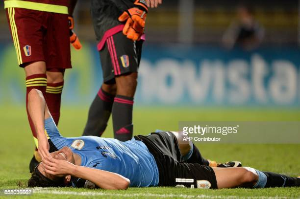 Uruguay's Edinson Cavani gestures on the ground during their 2018 World Cup qualifier football match against Venezuela in San Cristobal Venezuela on...