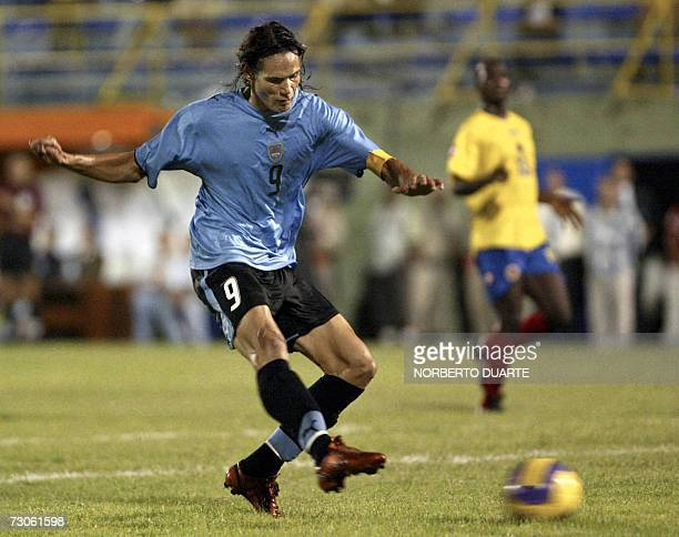 Uruguay's Edinson Cavani kicks the ball to score against Colombia during their South American Under20 championship soccer match in Luque Paraguay 21...