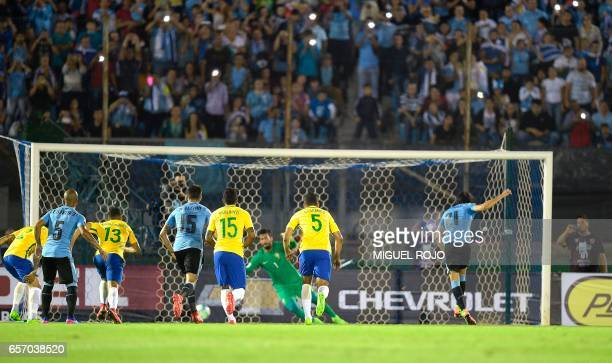 Uruguay's Edinson Cavani scores a goal against Brazil during their 2018 FIFA World Cup qualifier football match in Montevideo Uruguay on March 23...