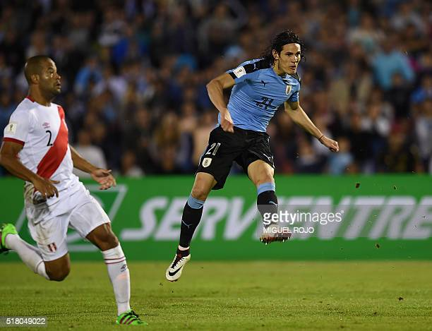 Uruguay's Edinson Cavani scores against Peru during their Russia 2018 FIFA World Cup South American Qualifiers' football match at the Centenario...