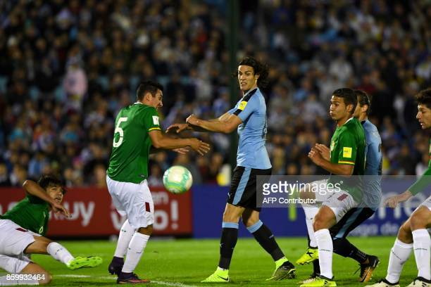 Uruguay's Edinson Cavani vies for the ball with Bolivia's Gabriel Valverde during their 2018 World Cup football qualifier match in Montevideo on...