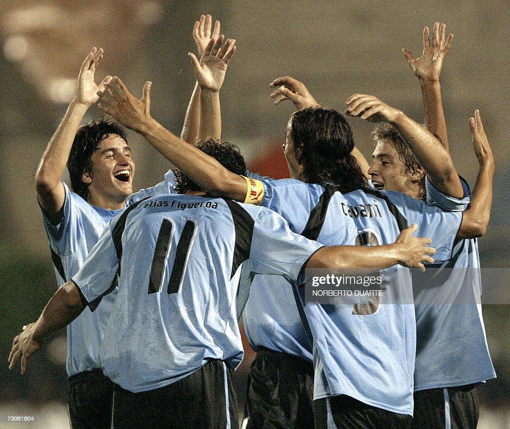 Uruguay s Elias Figueroa L celebrates