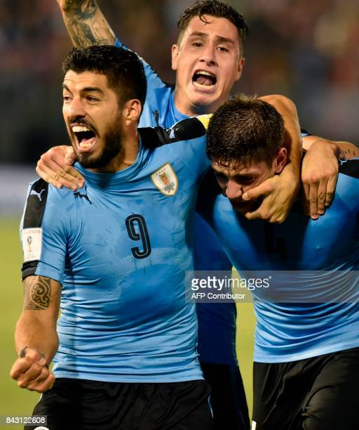 Uruguay's Federico Valverde celebrates with teammates Luis Suarez and Jose Maria Gimenez after scoring against Paraguay during their 2018 World Cup...