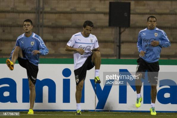 Uruguay's football player Andres Scotti attends a training session with his teammates at Amman International Stadium on November 12 2013 on the eve...