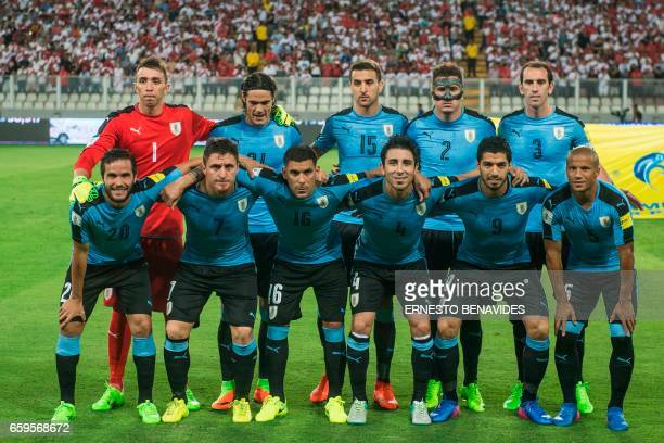 Uruguay's football team players pose for pictures before the start of their 2018 FIFA World Cup qualifier football match against Peru in Lima on...