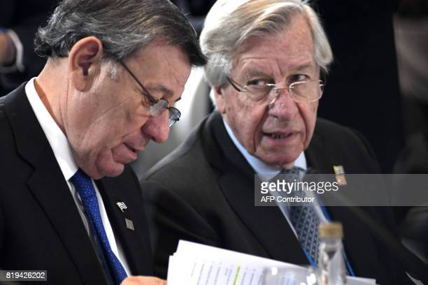 Uruguay's Foreign Minister Rodolfo Nin Novoa and Economy Minister Danilo Astori participate in the opening of the Mercosur Summit in Mendoza 1050 km...