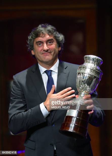 Uruguay's former football star Enzo Francescoli acknowledges the audience after receiving a commemorative trophy during the celebration of Conmebol's...