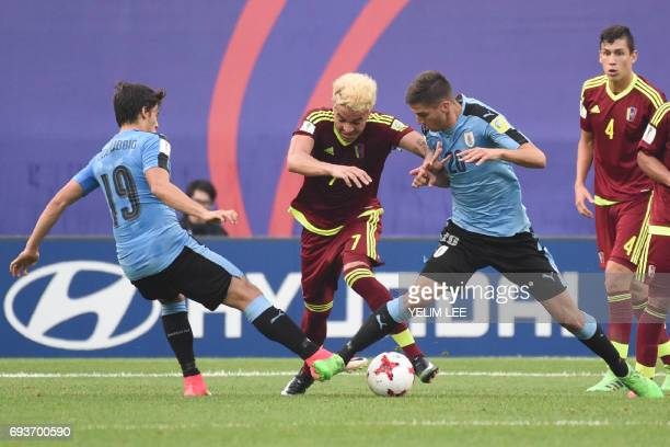 Uruguay's forward Agustin Canobbio and midfielder Rodrigo Bentancur tackle Venezuela's forward Adalberto Penaranda Maestre during the U20 World Cup...