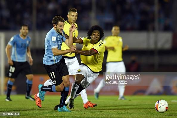 Uruguay's forward Christian Stuani vies with Colombia's Carlos Sanchez during their Russia 2018 FIFA World Cup South American Qualifiers football...