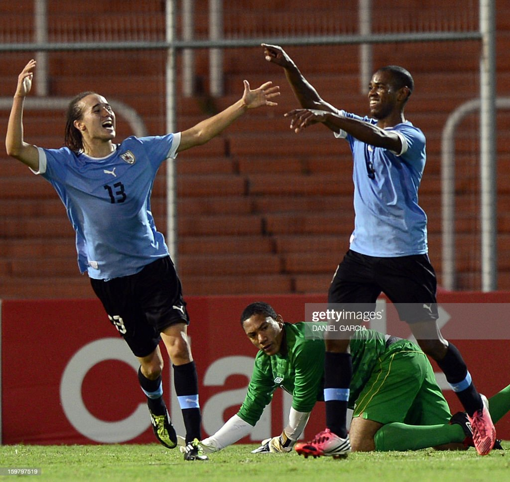 Uruguay's forward Diego Rolan (R) celebrates with teammate midfielder Diego Laxalt Suarez after scoring the third goal in front of Peru's goalkeeper Andy Vidal during their South American U-20 final round football match at Malvinas Argentinas stadium in Mendoza, Argentina, on January 20, 2013. Uruguay won by 3-1. Four teams will qualify for the FIFA U-20 World Cup Turkey 2013. AFP PHOTO / DANIEL GARCIA