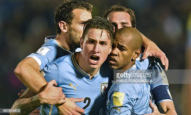 Uruguay's forward Diego Rolan celebrates with teammates Jose Maria Gimenez Christian Stuani and Diego Godin after scoring against Colombia during...