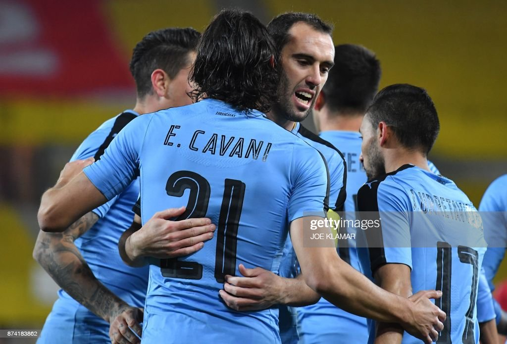 Uruguay's forward Edinson Cavani (C) celebrates his goal with his teammate Diego Godin during the international friendly football match Austria v Uruguay in Vienna, on November 14, 2017. /