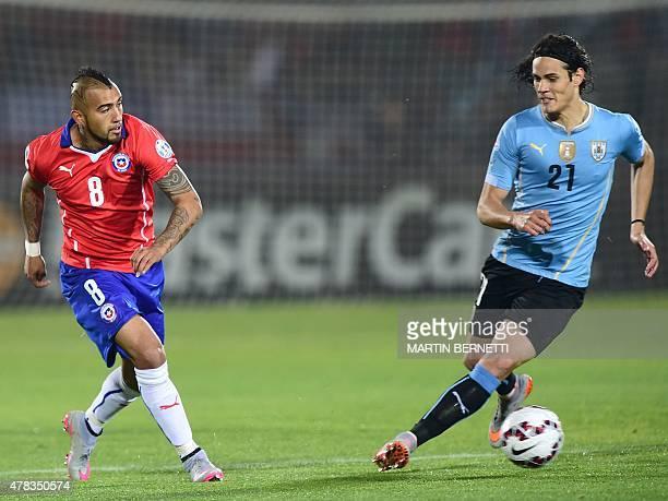 Uruguay's forward Edinson Cavani vies for the ball with Chile's midfielder Arturo Vidal during their 2015 Copa America football championship...