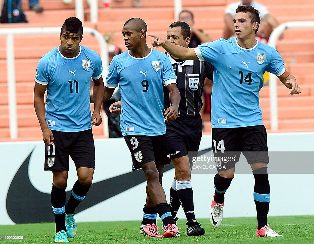 Uruguay's forward Gonzalo Bueno (R) celebrates with teammates midfielder Rodrigo Aguirre (L) and forward Diego Rolan after scoring against Chile during their South American U-20 final round football match at Malvinas Argentinas stadium in Mendoza, Argentina, on January 27, 2013. Four South American teams will qualify for the FIFA U-20 World Cup Turkey 2013.