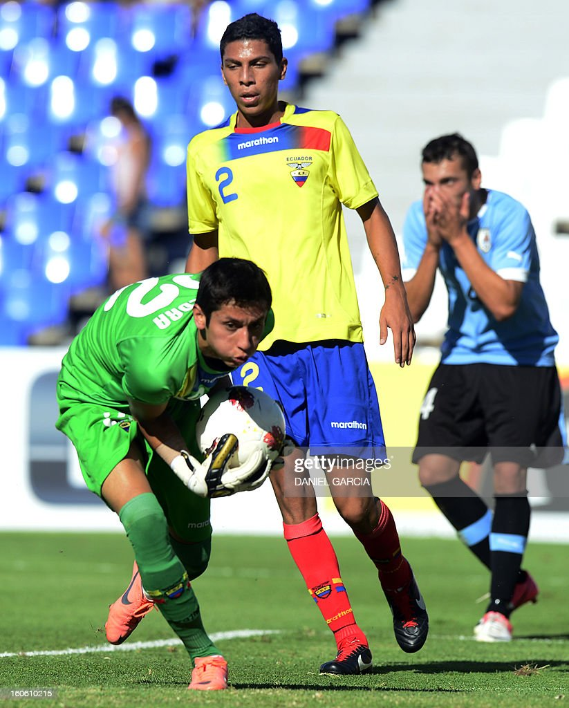 Uruguay's forward Gonzalo Bueno (R) reacts as Ecuador's goalkeeper Hamilton Piedra grabs the ball next to defender Luis Leon (C) during their South American U-20 final round football match, at Malvinas Argentinas stadium in Mendoza, Argentina, on February 3, 2013. Four South American teams will qualify for the FIFA U-20 World Cup Turkey 2013.