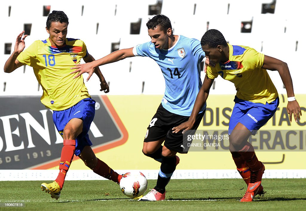 Uruguay's forward Gonzalo Bueno (C) vies for the ball with Ecuador's midfielder Andres Ona (L) and midfielder Carlos Gruezo, during their South American U-20 final round football match, at Malvinas Argentinas stadium in Mendoza, Argentina, on February 3, 2013. Four South American teams will qualify for the FIFA U-20 World Cup Turkey 2013.