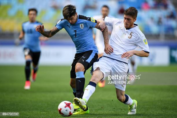 Uruguay's forward Joaquin Ardaiz and Italy's defender Filippo Romagna compete for the ball during the U20 World Cup third place playoff football...