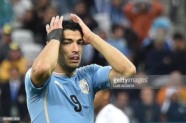 Uruguay's forward Luis Suarez reacts after missing a goal opportunity during a Group D football match between Uruguay and England at the Corinthians...