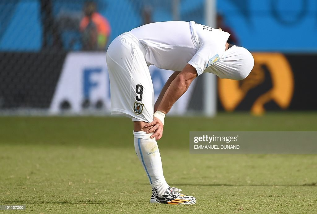 Uruguay's forward Luis Suarez reacts after the Group D football match between Italy and Uruguay at the Dunas Arena in Natal during the 2014 FIFA World Cup on June 24, 2014.