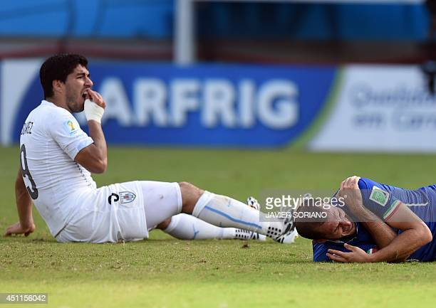 Uruguay's forward Luis Suarez reacts past Italy's defender Giorgio Chiellini during a Group D football match between Italy and Uruguay at the Dunas...